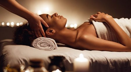 Spa woman. Girl having massage and enjoying aroma therapy in spa salon