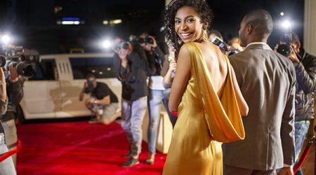 Portrait of smiling celebrity leaving red carpet event