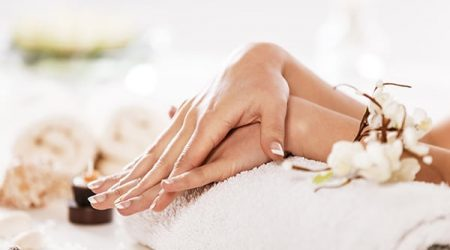 Woman in spa enjoying nail and hand treatment.