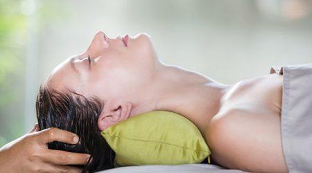 Head scalp massage in the spa salon.Shirodhara, an Ayurvedic hea