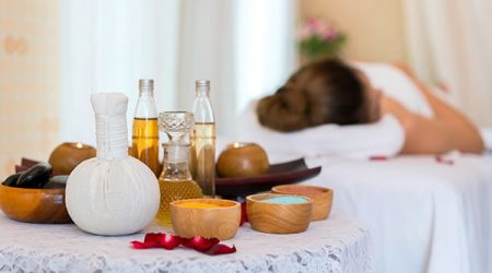 Rolled, compress balls, bottle oil, salt, towels, bowl, stone and candlelight. Treatment therapy spa thai and cleaning body. concept of beauty salon spa.