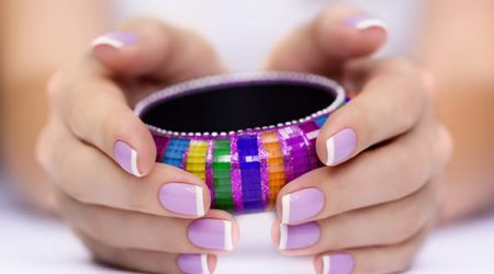 Bright multi-colored bracelet in woman's hands