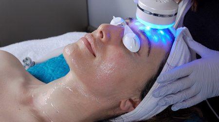 Woman receiving LED Microcurrent Facial