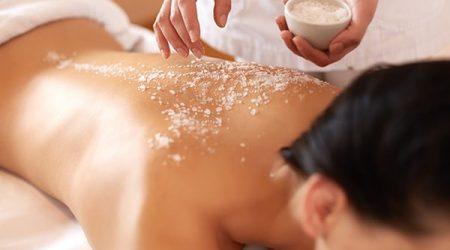 Spa Woman. Brunette Getting a Salt Scrub Beauty Treatment in the Health Spa. Body Scrub.