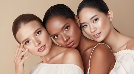Beauty. Group Of Diversity Models Portrait. Multi-Ethnic Women With Different Skin Types Posing On Beige Background. Tender Multicultural Girls Standing Together And Looking At Camera.